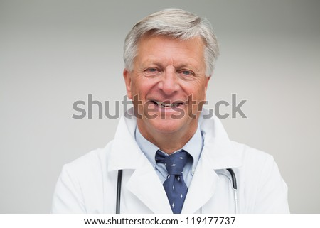 Mature doctor smiling in hospital