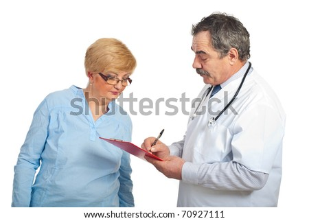 Mature doctor writing prescription to patient woman isolated on white background - stock photo