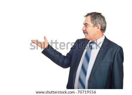 Mature executive man making presentation to copy space isolated on white background - stock photo