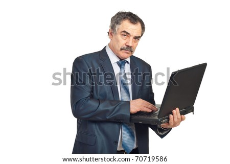 Mature executive man using laptop and looking at camera isolated on white background - stock photo