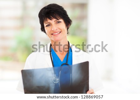 mature female medical doctor with x ray