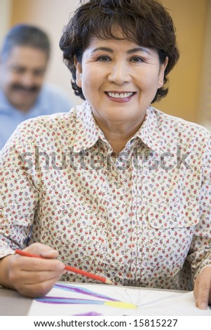 Mature female student in art class - stock photo
