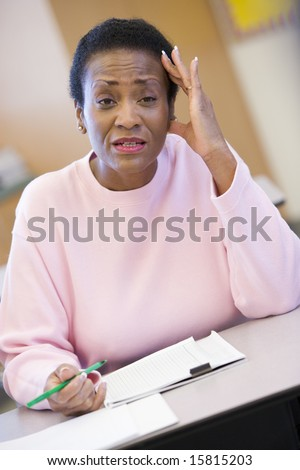 Mature female student looking confusion in class