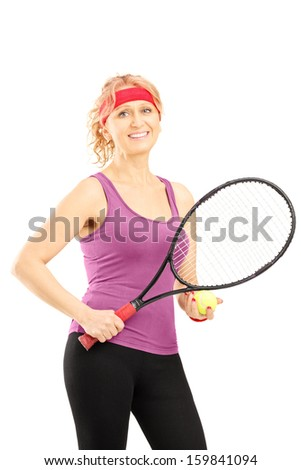 Mature female tennis player holding a racket and a ball isolated against white background - stock photo