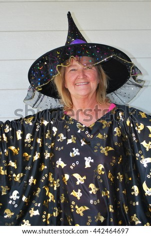 Mature female wearing a halloween costume outside.
