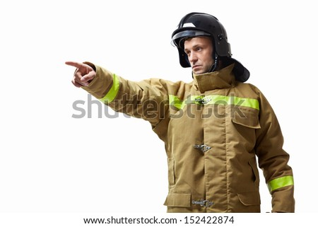 Mature fireman in uniform on a white background - stock photo