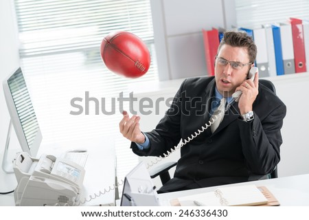 Mature football manager working in the office - stock photo