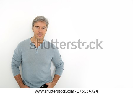 Mature handsome man standing on white background - stock photo