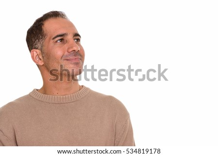 Mature happy Persian man thinking