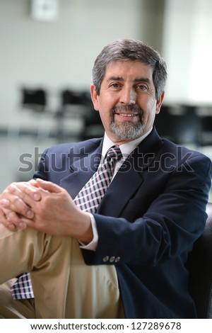Mature Hispanic businessman inside an office building - stock photo