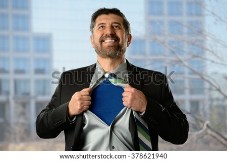 Mature Hispanic businessman opening shirt with office building in background - stock photo