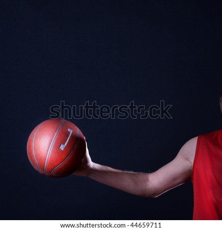 Mature holding his ball - stock photo