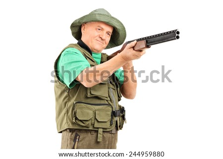 Mature hunter aiming with a shotgun isolated on white background