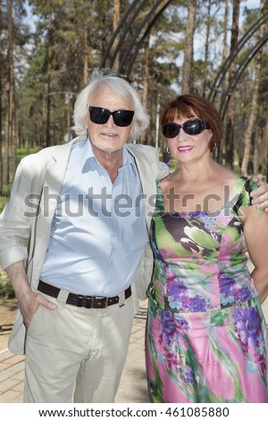 Mature husband and wife walking in a recreation park