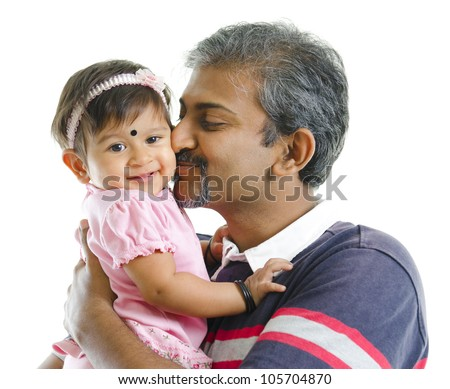 Mature Indian father kissing baby girl, isolated on white background - stock photo