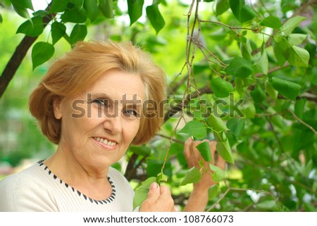 Mature lady enjoys union with nature, fresh air and stunning views