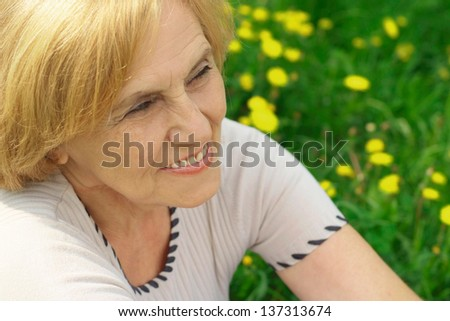 Mature lady enjoys union with nature, fresh air and stunning views - stock photo