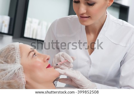 Mature lady is getting beauty injection in clinic