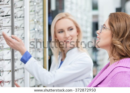 Mature lady is ready to buy eyeglasses - stock photo