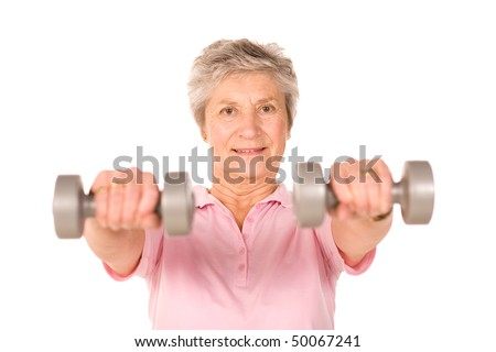 Mature lady lifting weights during gym workout - stock photo