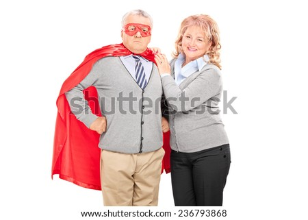 Mature lady posing next to her superhero husband isolated on white background - stock photo