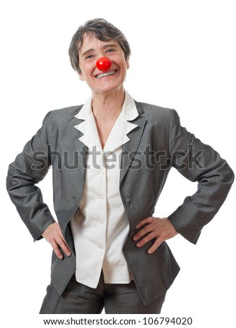 mature lady with red nose smiling on white background - stock photo