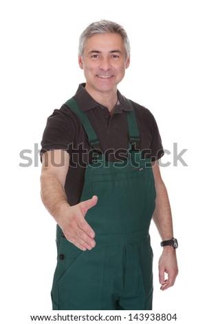 Mature Male Gardner Offering Handshake Over White Background - stock photo