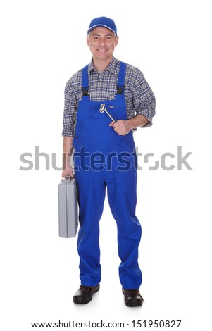 Mature Male Technician Holding Worktool Over White Background