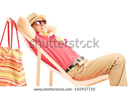 Mature male tourist enjoying on a beach chair isolated on white background - stock photo