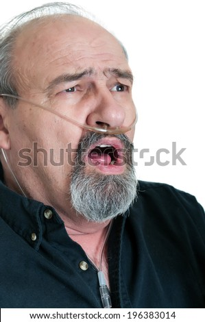 Mature male with Oxygen tubing for COPD or emphysema showing surprise - stock photo