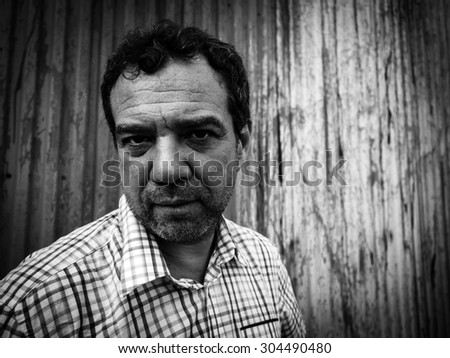 Mature man against the wall