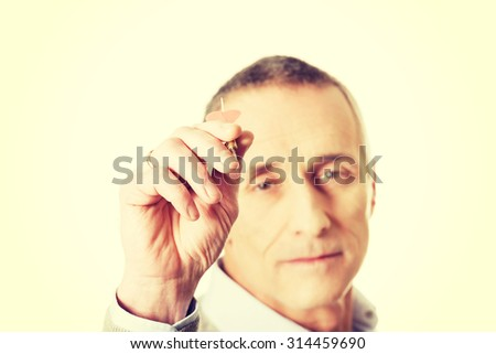 Mature man aiming by dart. - stock photo