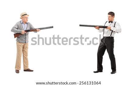 Mature man and a young guy having a shootout with shotguns isolated on white background - stock photo
