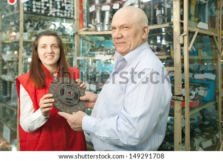 mature man and woman with  clutch  in  auto parts store
