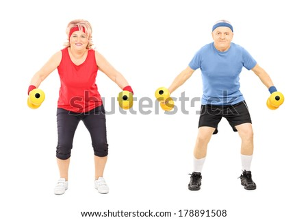 Mature man and woman working out with dumbbells isolated on white background - stock photo