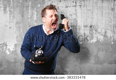 mature man angry talking on telephone - stock photo