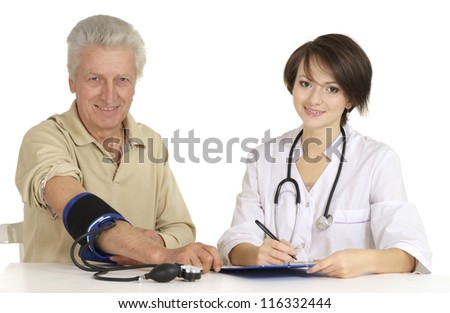 Mature man came to the reception to the doctor - stock photo