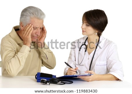 Mature man came to the reception to the nice doctor - stock photo