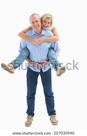 Mature man carrying his partner on his back on white background - stock photo