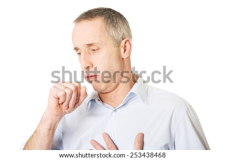Mature man coughing because of flu. - stock photo