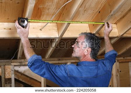 Mature man doing home renovations.  - stock photo