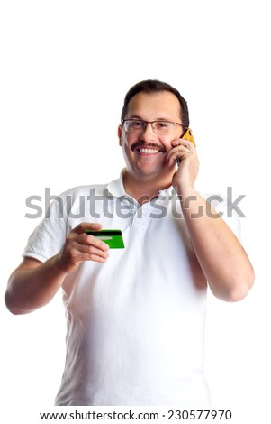 Mature man doing some telephone banking and giving the bank his debit card number, isolated on white background - stock photo