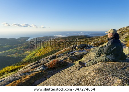 Mature Man Enjoying View from Mountain - stock photo