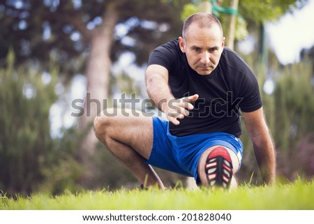 Mature man exercise in a city park - stock photo