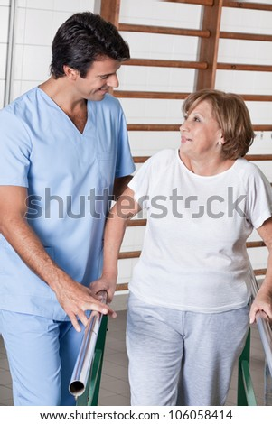 Mature man having ambulatory therapy with his therapist. - stock photo