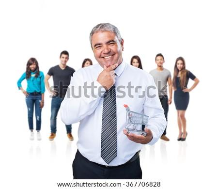 mature man holding a shopping cart - stock photo