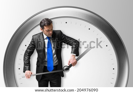 Mature man in a suit with a clock - stock photo
