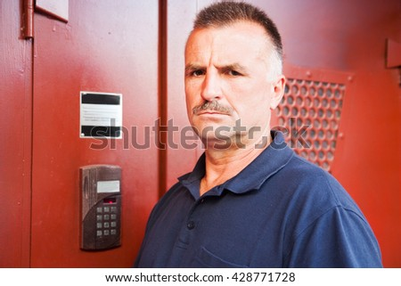 mature man is concerned about the broken intercom