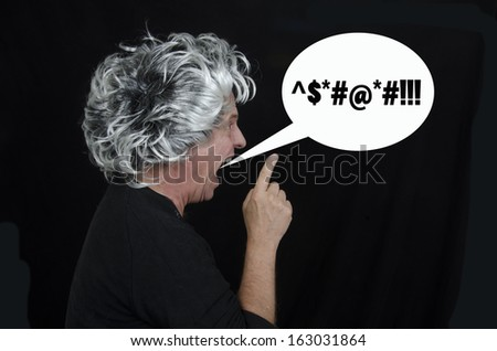 Mature man is yelling expletives/Man Yelling/Mature man pointing finger with expletives is a bubble.  - stock photo