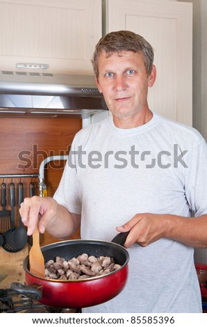 mature man makes to itself a supper - stock photo